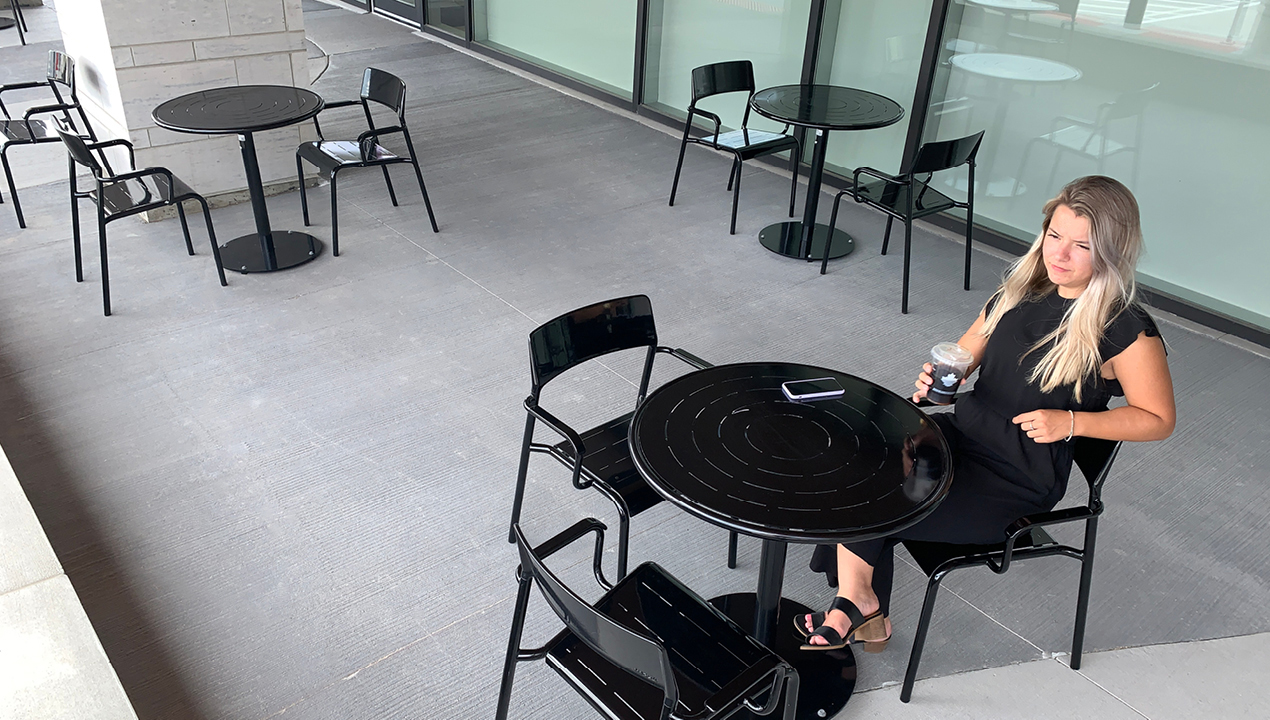Black Foro tables and chairs with pretty girl having coffee