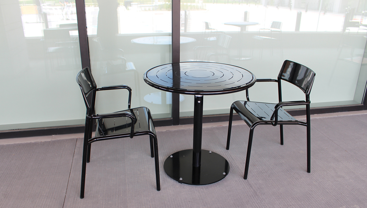 Black Foro round table with two backed chairs