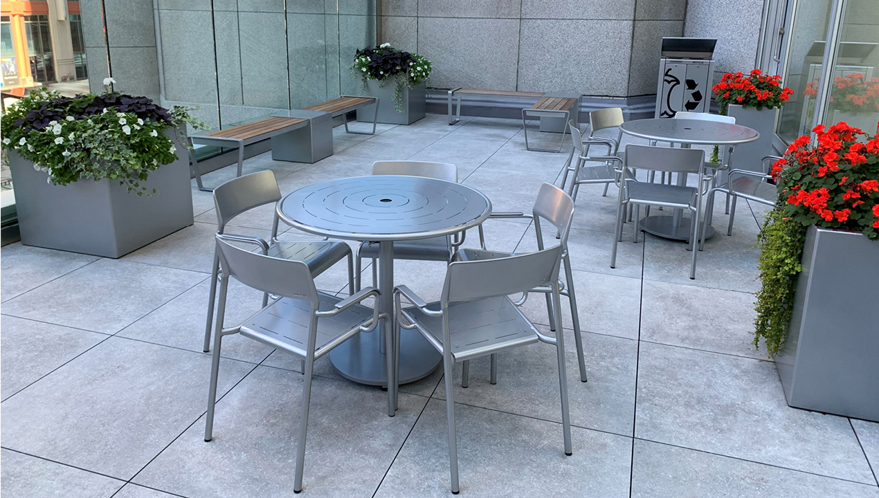Silver Foro table and chairs, 1500 planters and Lexicon