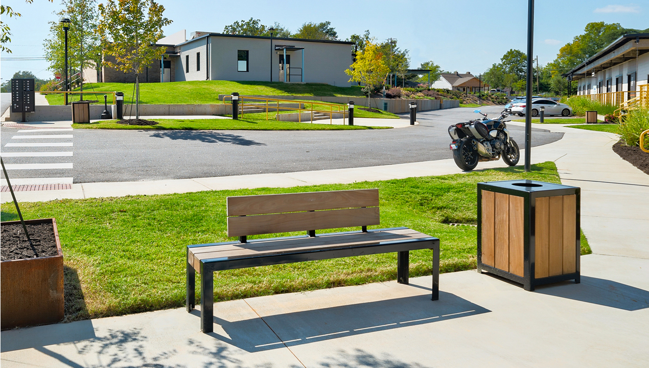 1050 Backed wood bench with wood trash container in neighborhood