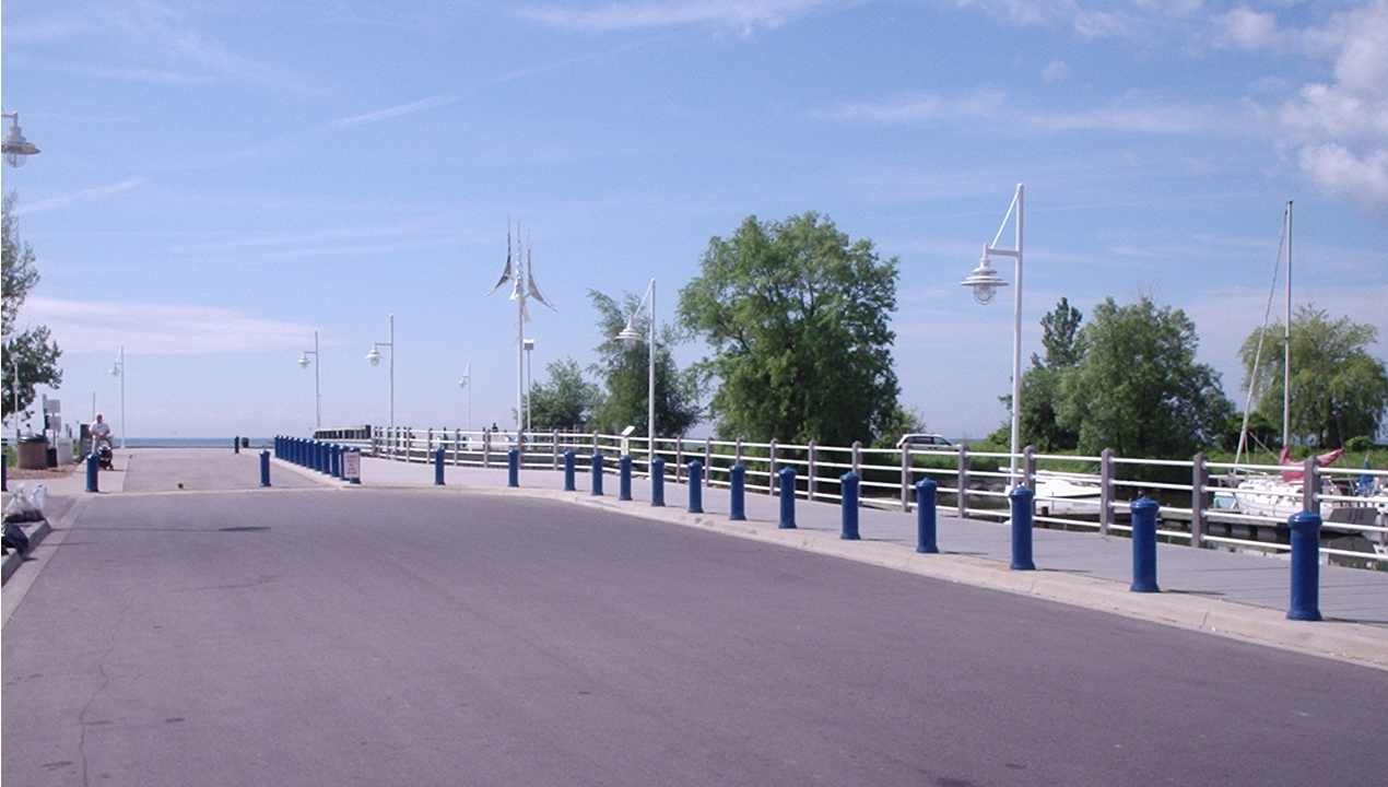 Blue sky and open road with blue bollards