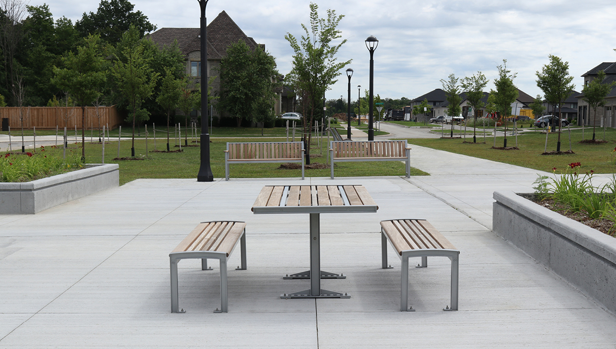 720 cluster seating - table with 2 backless benches in park setting