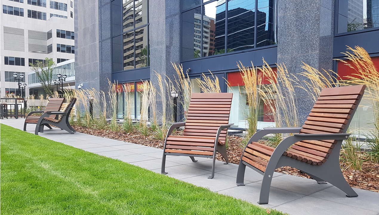 720 Wood Chairs on sidewalk next to building