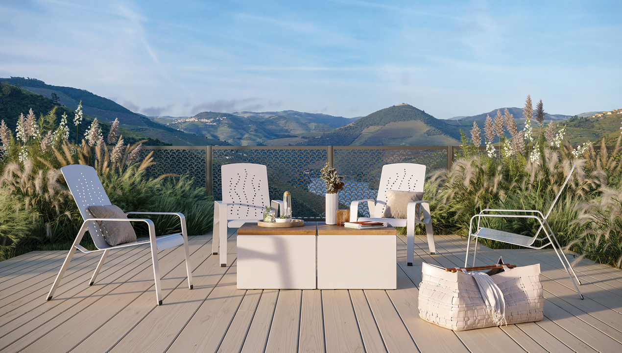 2700 Series - ALUM Lounge chairs with Pixel tables in picturesque mountain setting with beautiful greenery