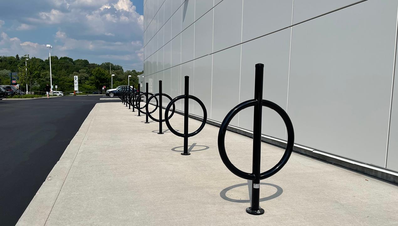 100 Series Bike Rack painted gloss black on sidewalk next to building