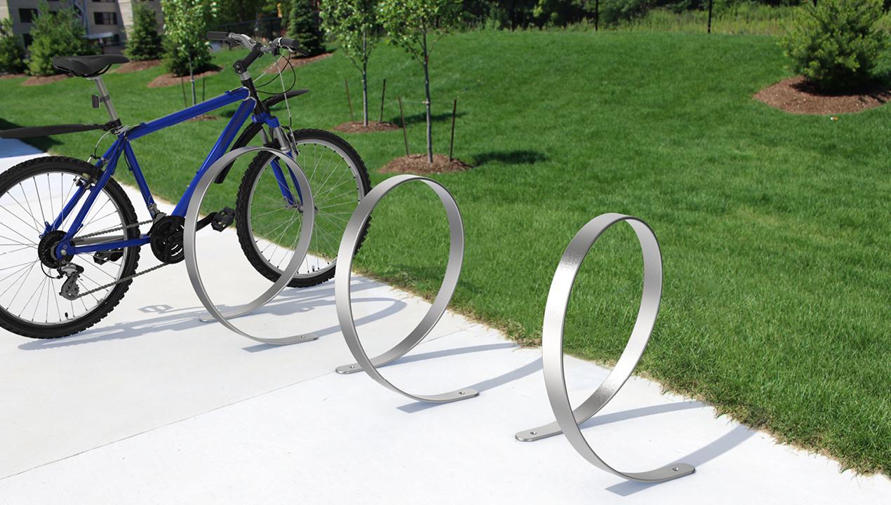 3100 Series - Orbit Stainless Steel Bike Racks with blue bicycle at park
