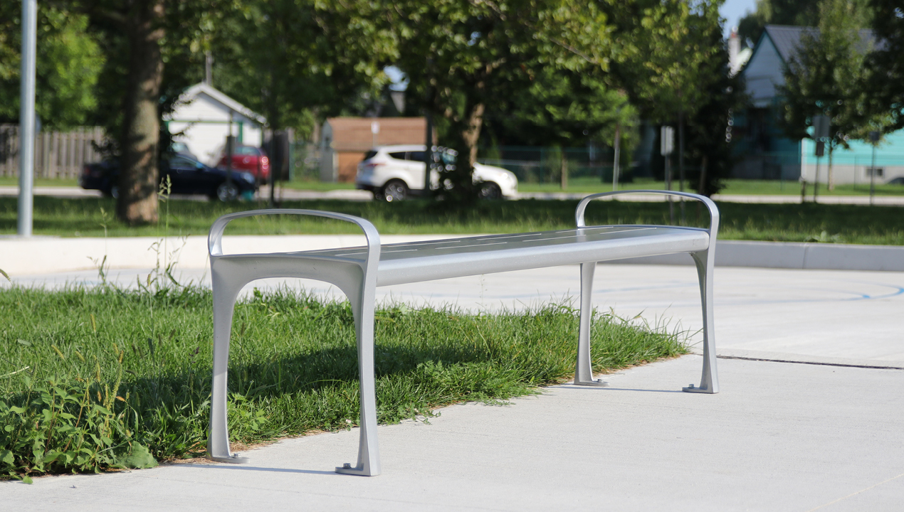 MBE-0870-00049: 870 Backless Metal Bench painted Silver 14 in park setting
