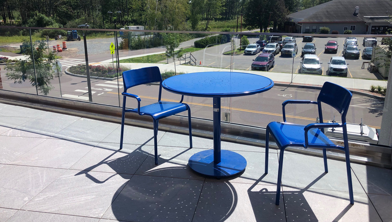 Foro Collection Round Table and Chairs, blue powdercoat on balcony