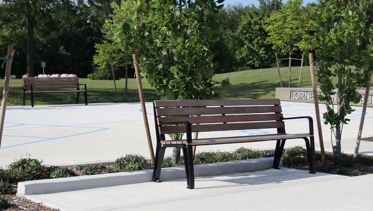 MBE-2300-00017: Iconic Backed Benches with Arms, Ipe Wood Seat and Back in park