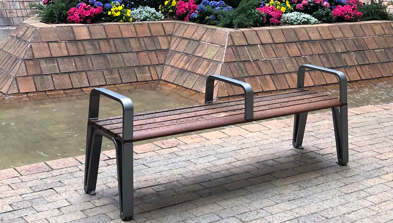 Iconic Backless bench with side and center arms in plaza